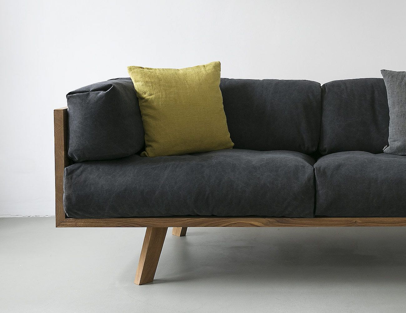 As the name suggests this modern and minimalistic sofa is made from solid oak wood