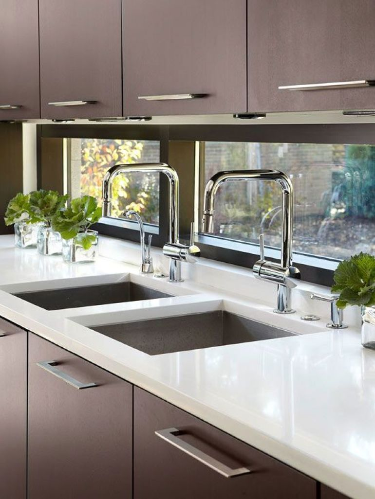 Kitchen sink window decor  seethrough backsplashes are a great way to open up and add light to