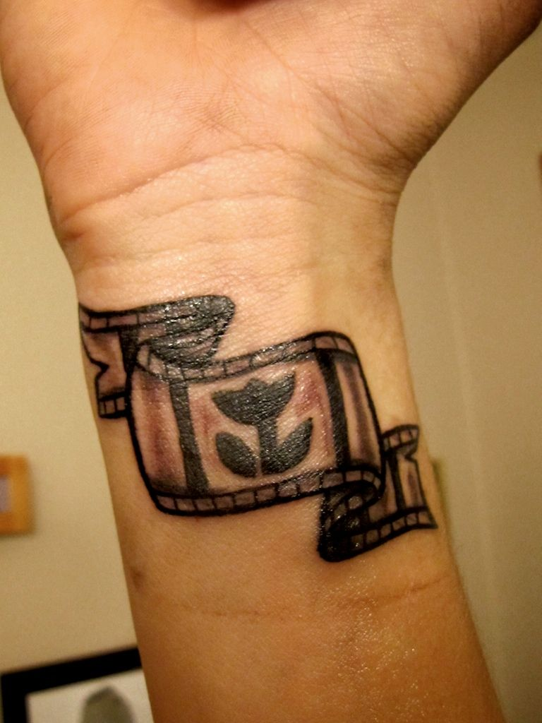 the tattoo design to decorate your body surface like it rh pinterest ca film strip tattoo meaning film strip tattoo ideas