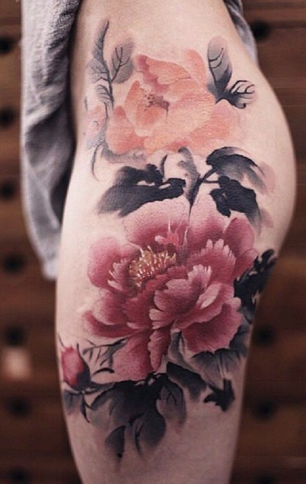 d7da812bb7f7e The play of water colors, the play of art and the play of creativity, all  can be seen in this amazing peony tattoo for your thigh.