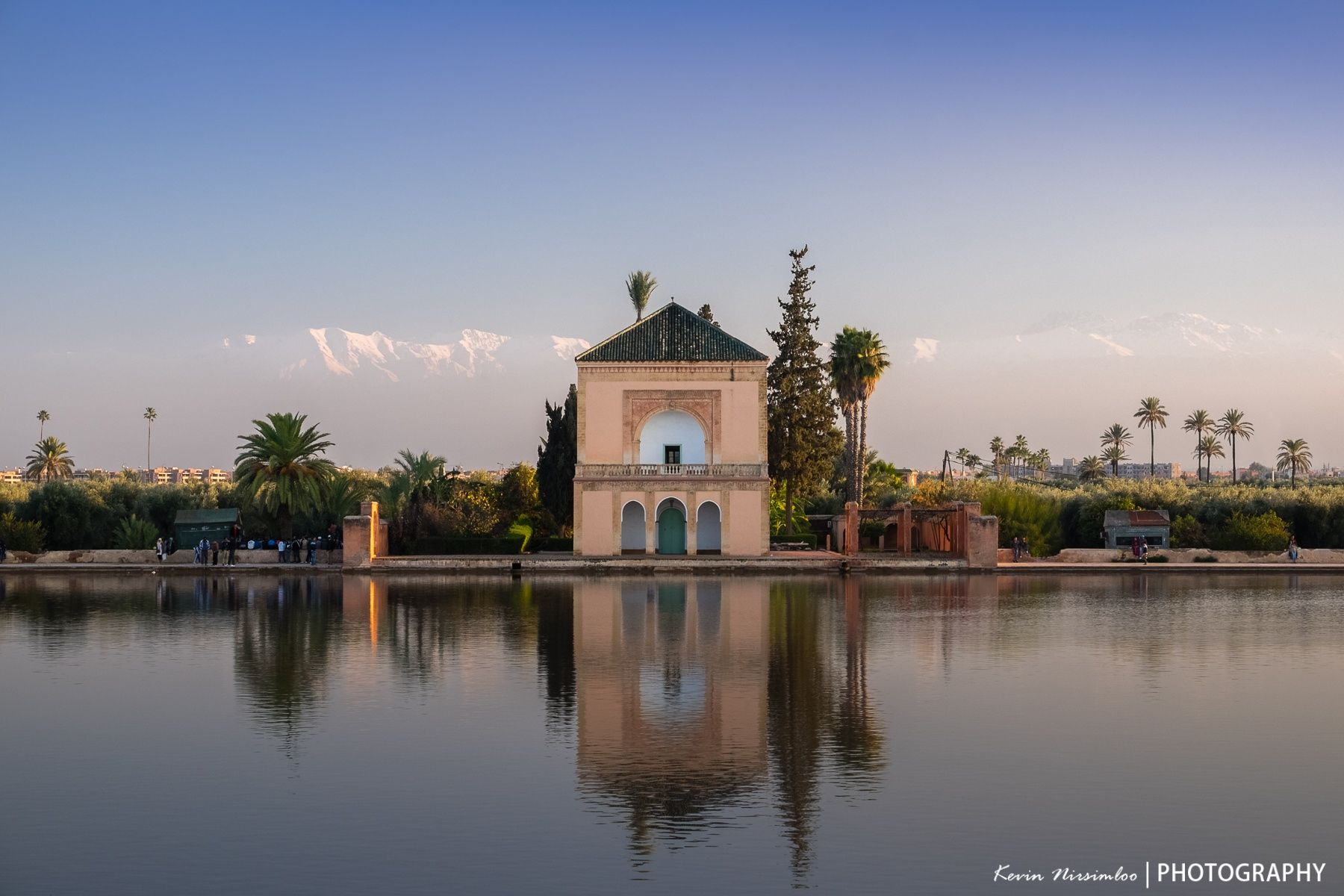 The Menara gardens are gardens located to the west of Marrakech, Morocco, at the gates of the Atlas mountains. They were built in the 12th century. The name Menara derives from the pavillon with its small green pyramid roof. The pavilion was built during the 16th century Saadi dynasty and renovated in 1869 by sultan Abderrahmane of Morocco, who used to stay here in summertime.
