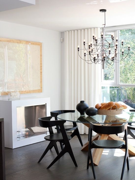 Glass Dining Table And Black Chairs White Fireplace To Add Some Element Of Fierceness