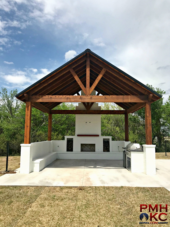 Custom Pavilion With A Fireplace Kitchen And Bench Retaining Wall Outdoor Pergola Backyard Patio Pergola