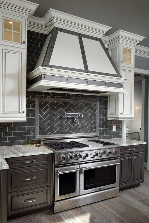 This interglass shimmer ceramic tile was the perfect choice for this beautiful kitchen backsplash white grout gives a modern edge to this charcoal subway