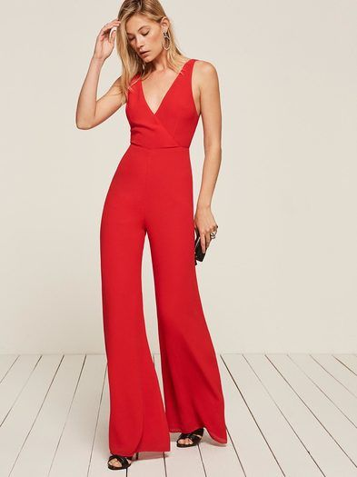 f6cee6346c The back of this jumpsuit is cancelled. This is an open back jumpsuit with  an overlapping v neckline and a wide leg. This style comes in petite sizes.