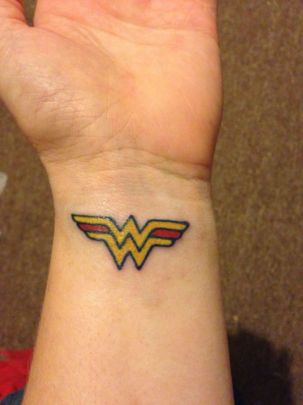 Flaming art tattoo for geek tattoo lovers this kind of batman - Wonder Woman Tattoo