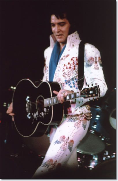 Elvis Presley : March 6, 1974 : Montgomery, Alabama, 8:pm  The performance had been a sell-out from the day word leaked out that Presley was going to be in town. There were 16,400 seats and the receipts ran around $104,000 for the local show alone and the Auburn crowd was about the same. When the perspiring Presley concluded his show, he was rushed out of the building through a heavily-guarded back door to keep the enthusiastic fans from mobbing him.
