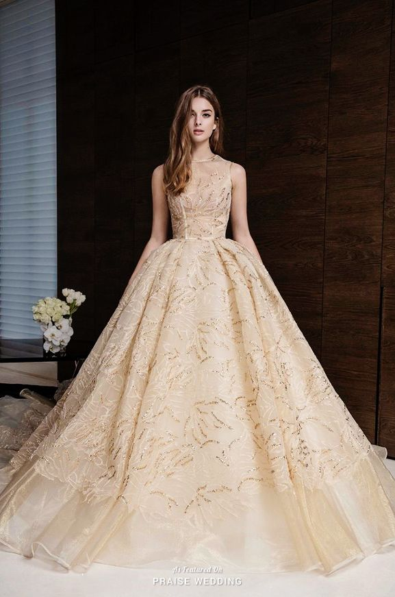 This golden ball gown from Nicole + Felicia adorned with ultra-chic ...
