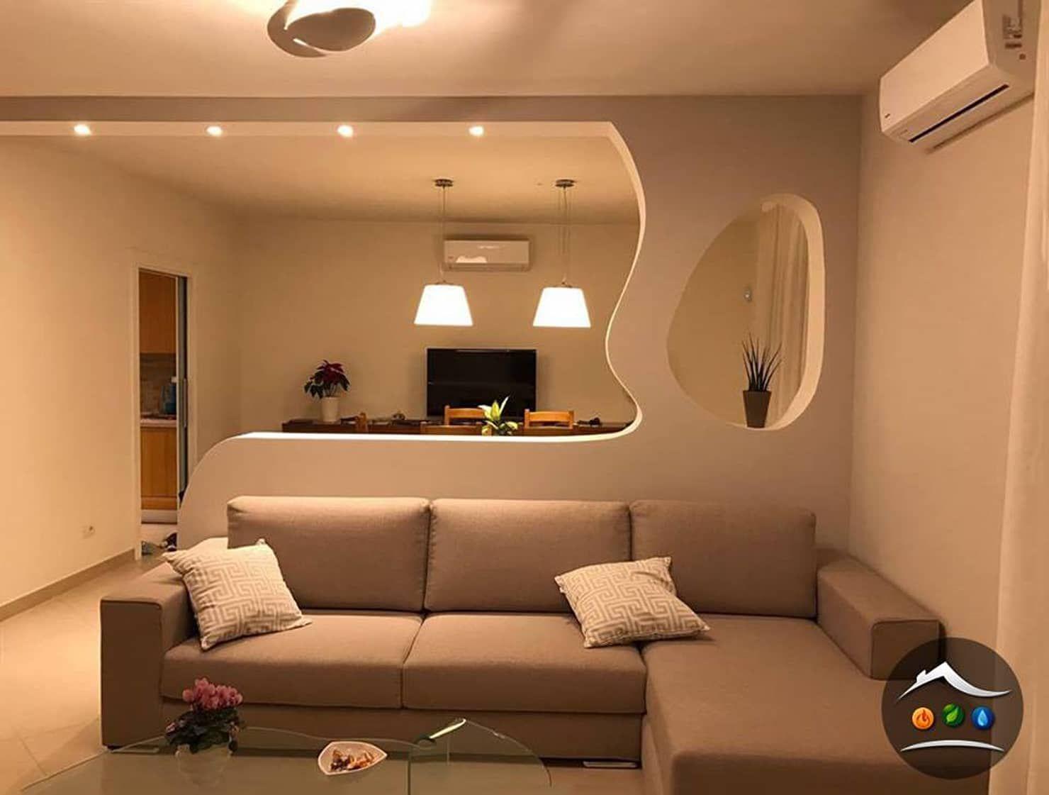 Parete di arredo in cartongesso in stile di cartongesso for Decorazioni per pareti soggiorno