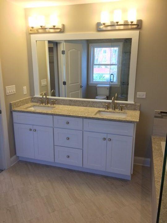 Put Trim Around Mirror And Add New Double Sink Cabinet