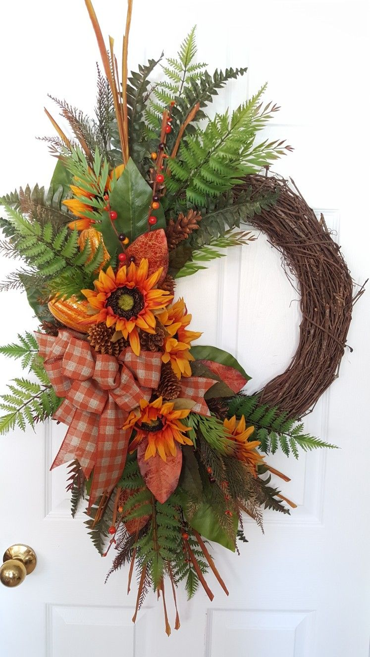 Fall grapevine wreath  Did do a little more tweaking on this one  As