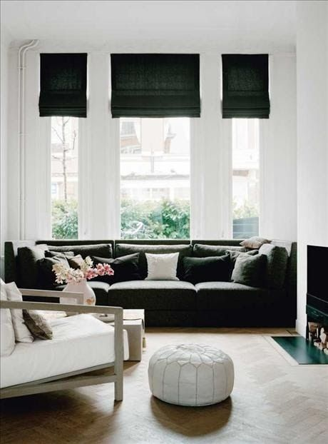 dark curtains with white in the lounge, i like the white poof and soft flowers