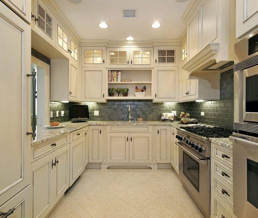 Contemporary Galley Style White Kitchen, White