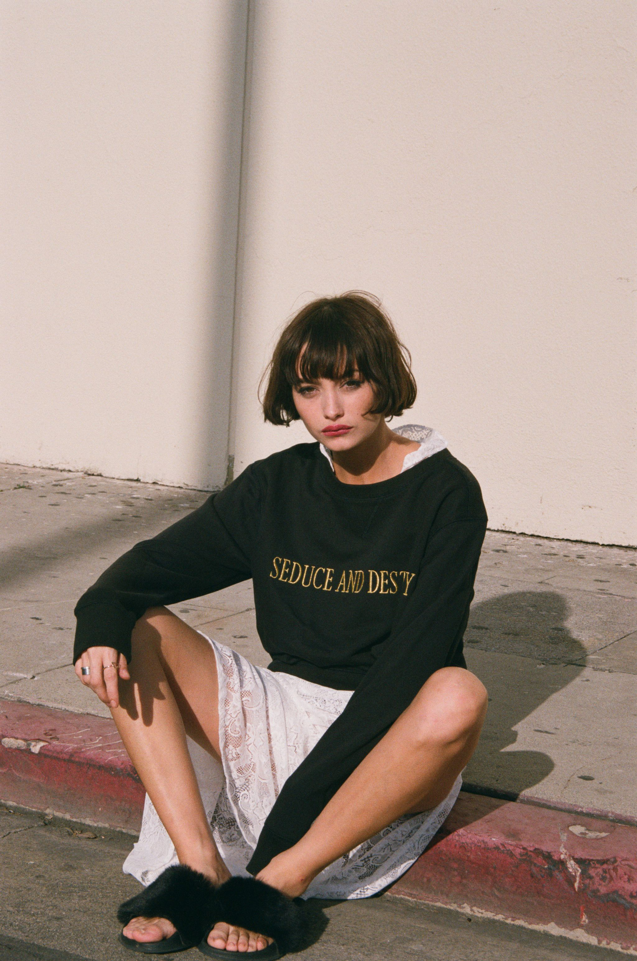 Taylor wearing our Seduce & Destroy Embroidered Sweat available online now loversanddrifters.com