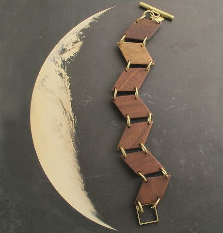 Our Zigzag Bracelet is made of blond poplar wood and vintage brass components.  $130.