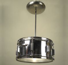 Drum pendant made from vintage snare drum and sauce pan cover!  Drum pendant made from vintage snare drum and sauce pan cover!
