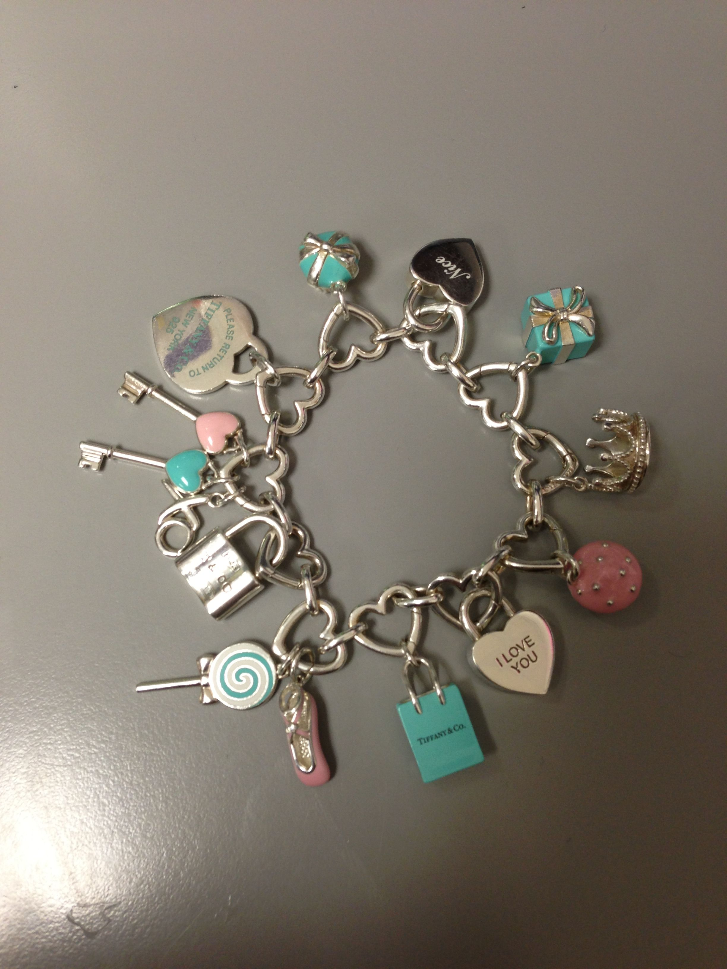50f7fcb85c6 Tiffanys charm bracelet filled!