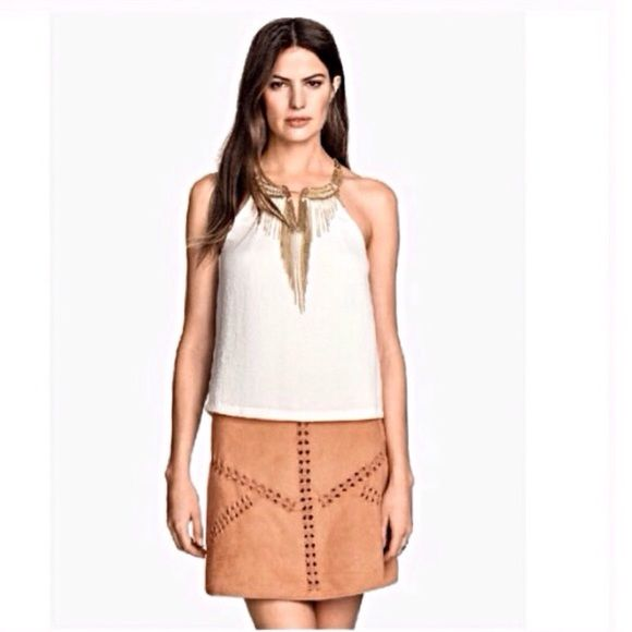 Boho chic suede skirt, NWT The braided detailing is definitely what makes this skirt unique!  It is fully lined with a zipper & snap closure in the back.  I really wish it fit me H&M Skirts Mini