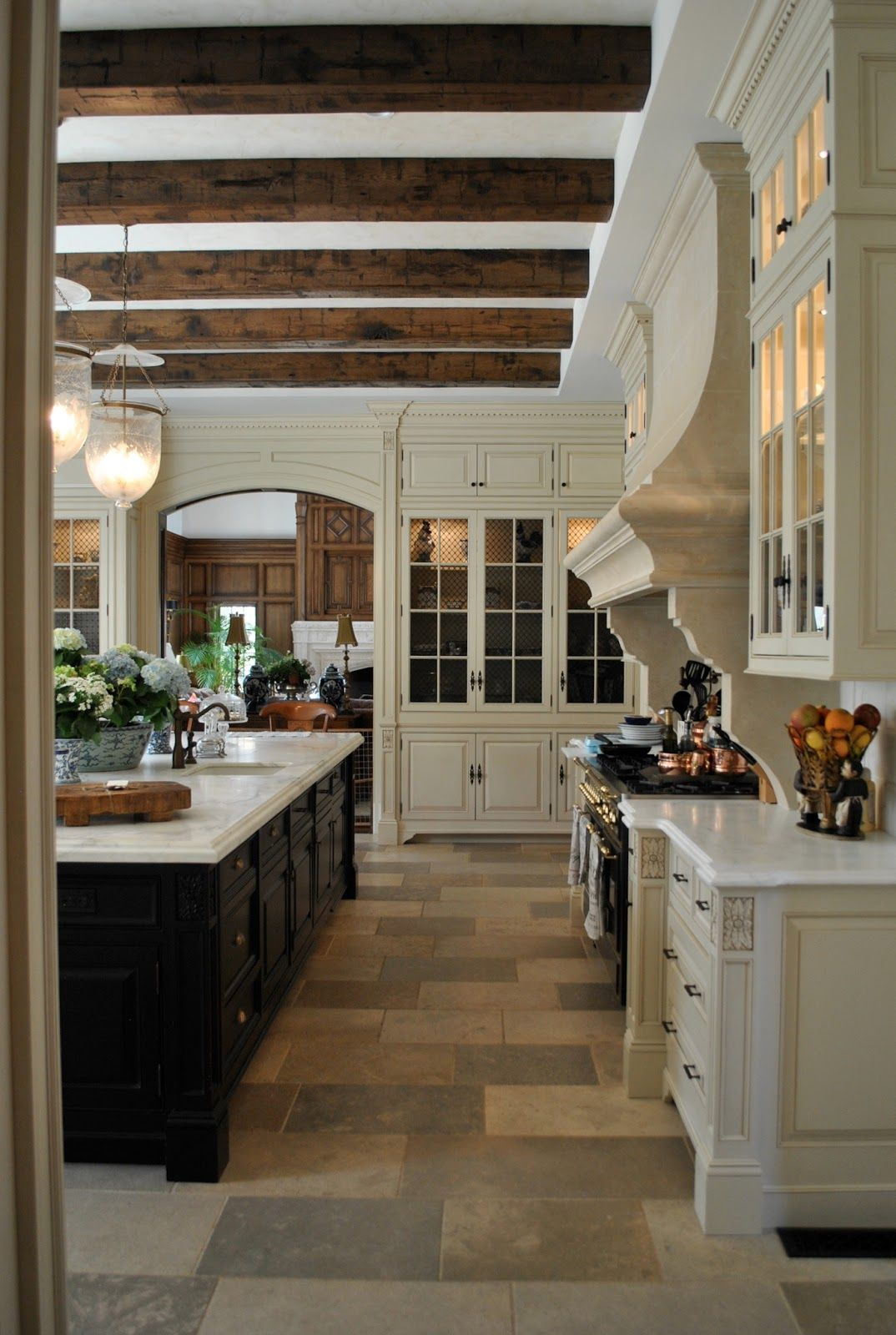 Kitchen in The Enchanted Home blog by Tina with French Country white cabinets and stone floors