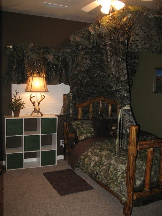 How to decorate a boys room in a hunting realtree camo theme..not that I  love this idea but Brian