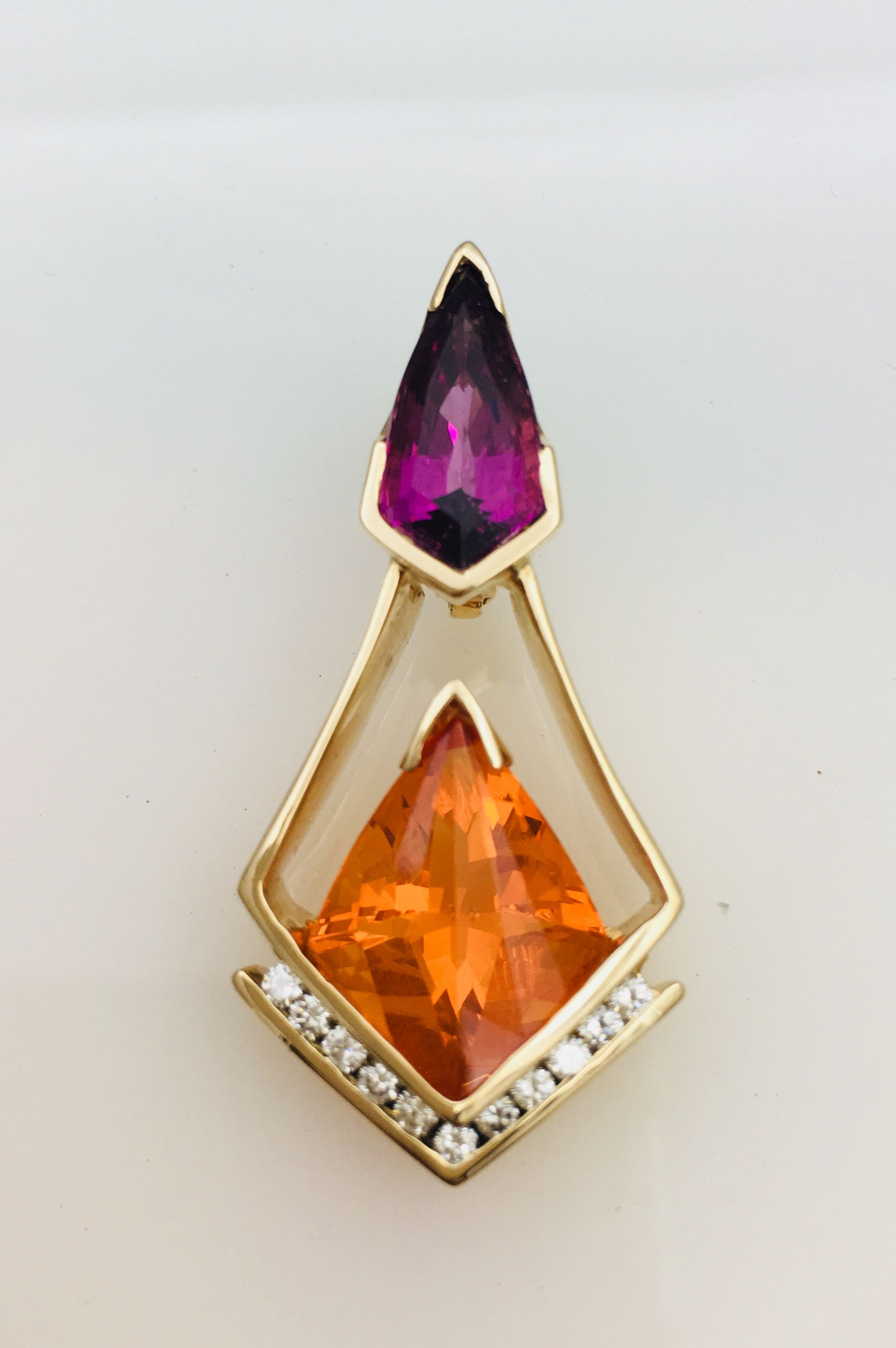 Outrageous fireopal with grape garnet and diamonds set in yellow