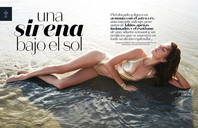 Photographed by Enrique Vega, Barbara poses on the beach in golden looks