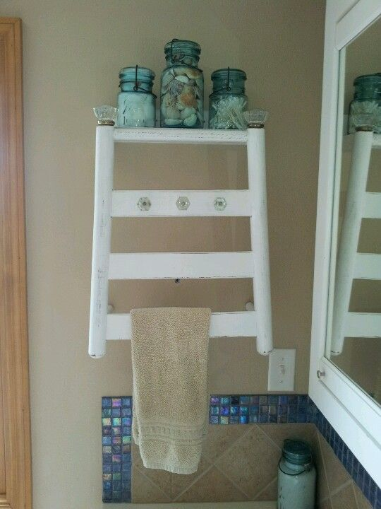 An old ladder-back chair became our new bathroom towel bar ...