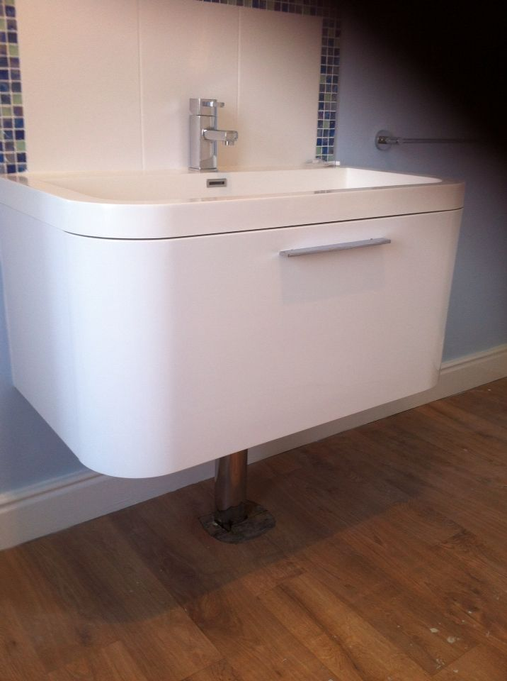 Wall hung sink with chrome tube to hide pipe work and for Bath waste pipe