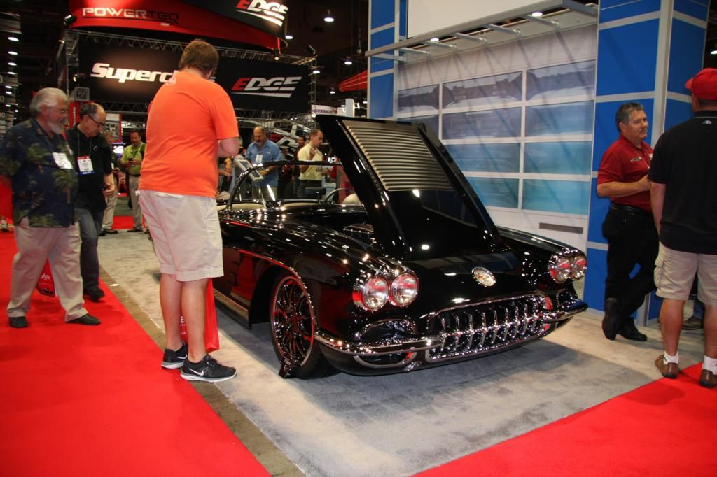 Crowd admiring custom car at 2012 SEMA