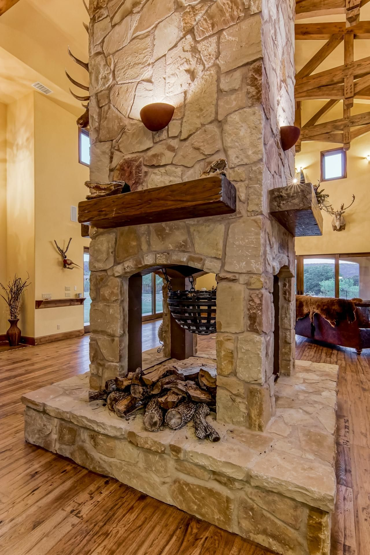 Custom Stone Fireplaces. 3 sided custom fireplaces  Google Search game room ideas