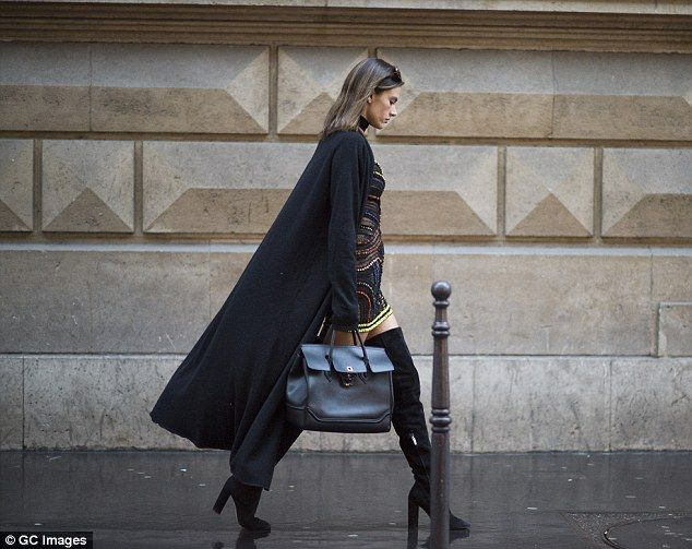 Centre of attention: The Victoria's Secret Angel certainly stood out as she powered along the streets of Paris