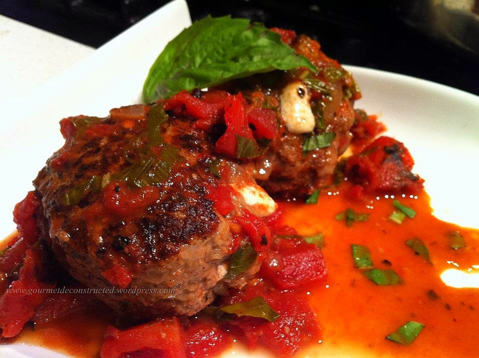 This is from the blog of one of my very cool culinary friends, Chef Justice Stewart of Brooklyn. Mozzarella Stuffed Elk Meatballs in Chilean Red Wine & Tomato Sauce...just WOW!