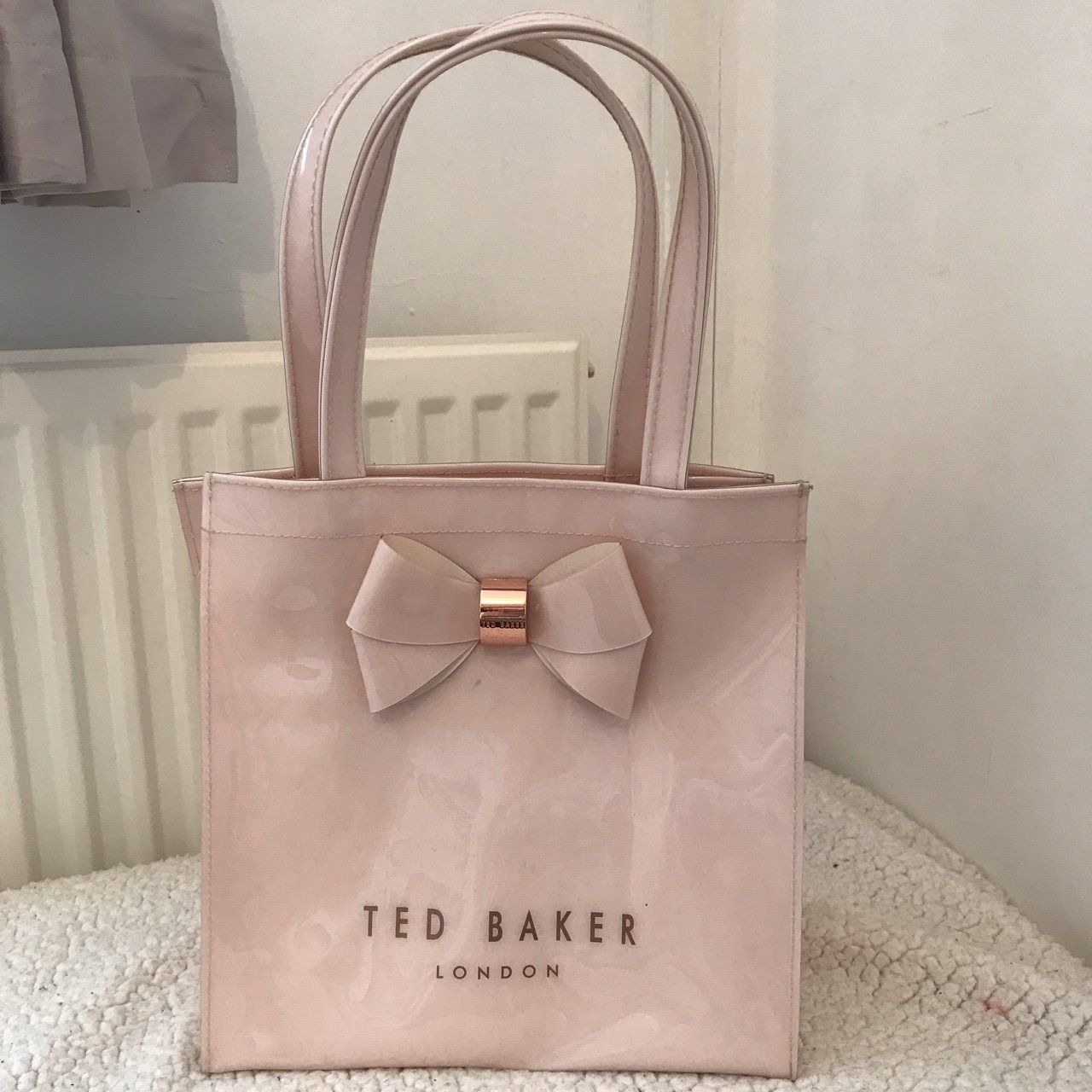 0175b4fa6b7a Baby doll pink small Ted Baker bag. Iconic bow on the front and  inscriptions on the side. Great condition and will make the perfect gift.