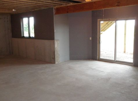 5 Benefits To Lowering Your Basement Walkout Basement Basement Walls Damp Basement