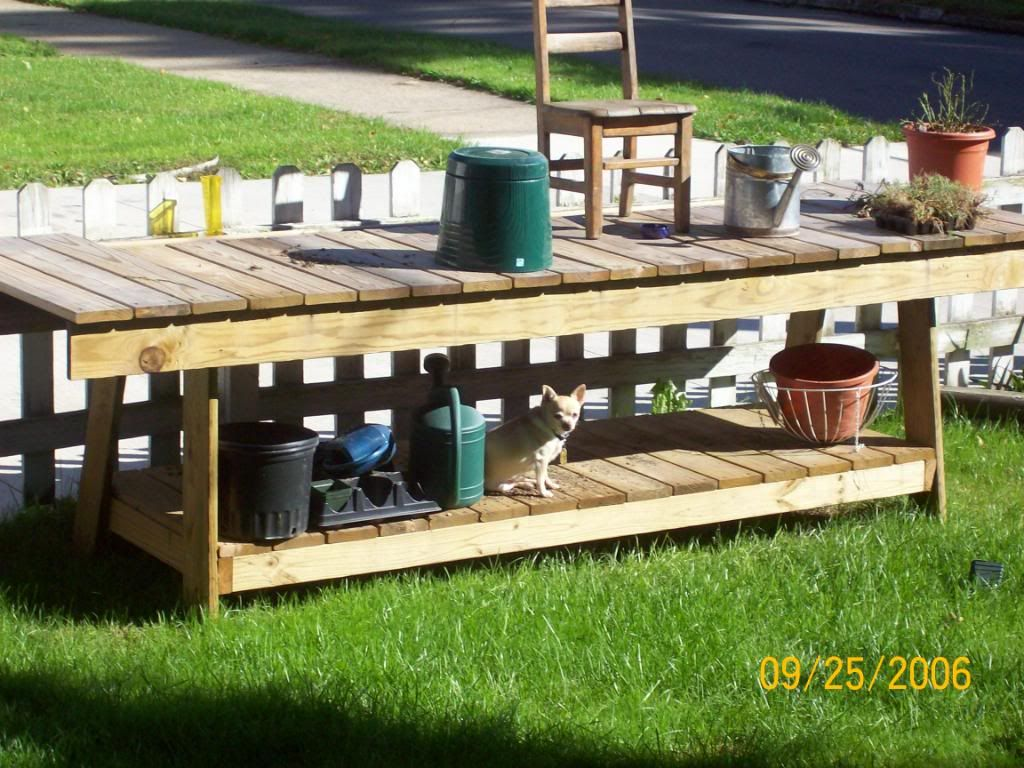 A potting bench that doubles as an outdoor buffet table.