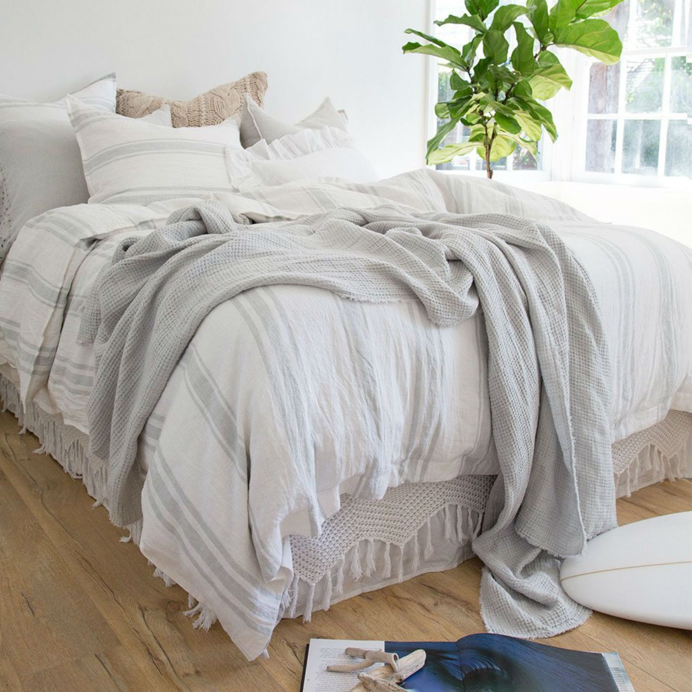 Indulge in the waffle-textured Venice Oversized Throw from Pom Pom at Home. This is the perfect throw blanket to wrap yourself with or to dress the foot of the bed.100% linen Fringe trim edge 60