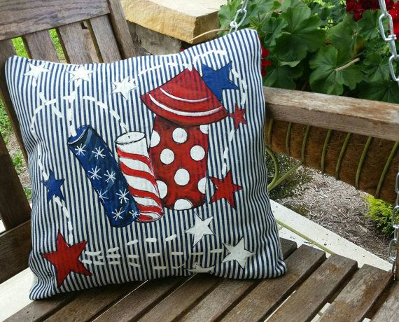 Fourth of July, Fireworks, Decorations, Patriotic Pillows, Americana, Indoor/Outdoor Cushions, Red, White, and Blue, Pillow Cover  Add your patriotic spirit to your indoor or outdoor space with our hand-painted American flag.  Fits a 18 x 18 inch pillow insert. The pillow insert is not included.  Features include:  Hand-painted. Navy and White Ticking. Double-stitched seams with over-locked to prevent fraying. All stress points reinforced for added durability.  Hand wash in cold water wi...