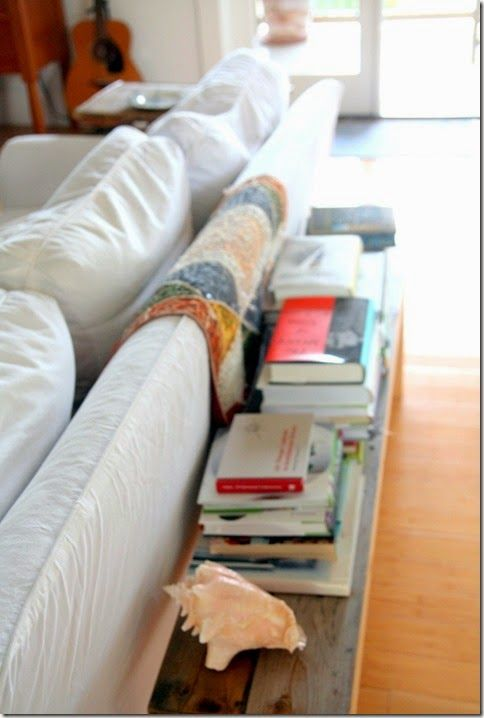 Merveilleux Wood Bench Behind Sofa With Book Stacks