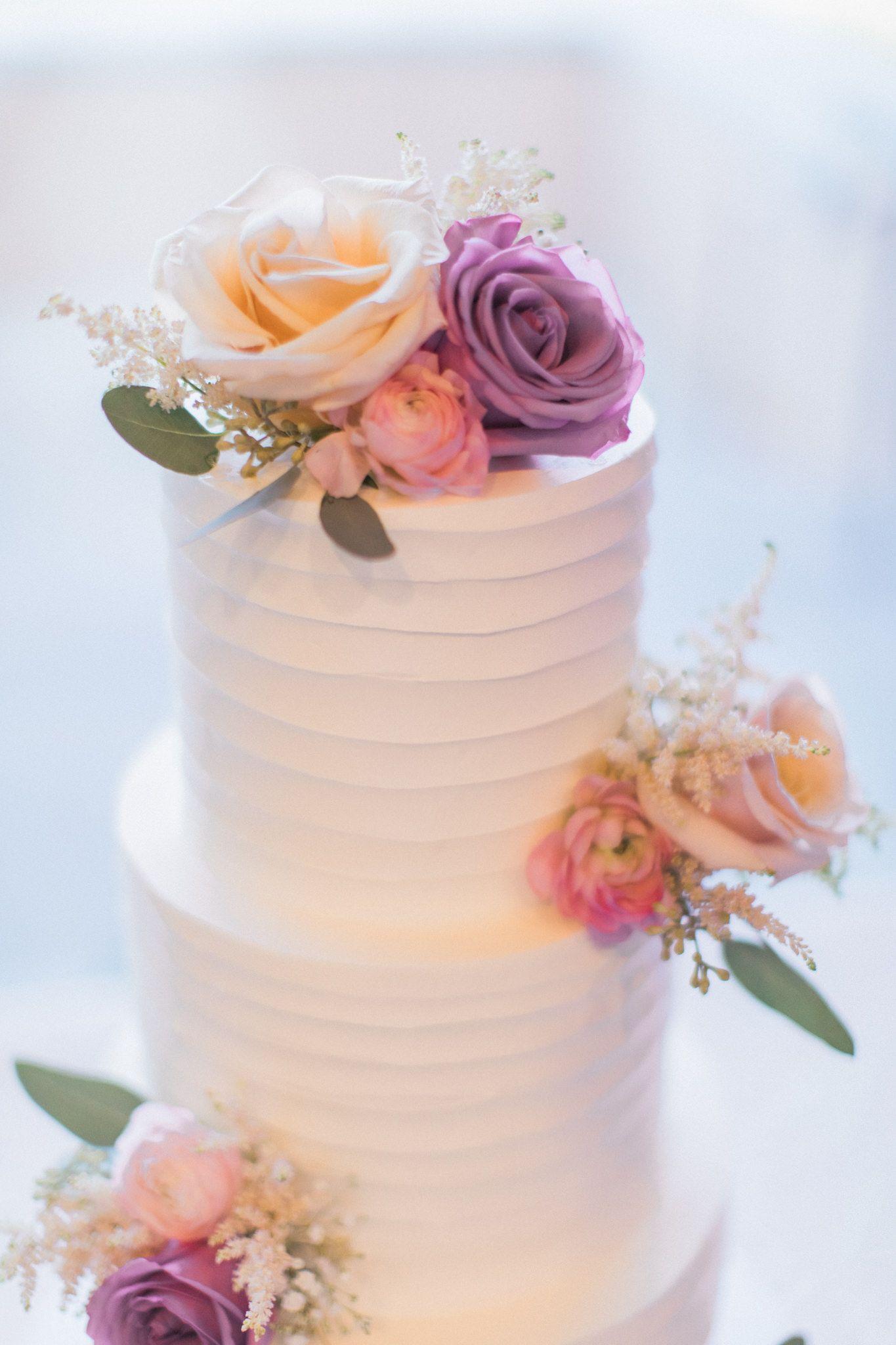 Fresh flowers on white wedding cake las vegas wedding