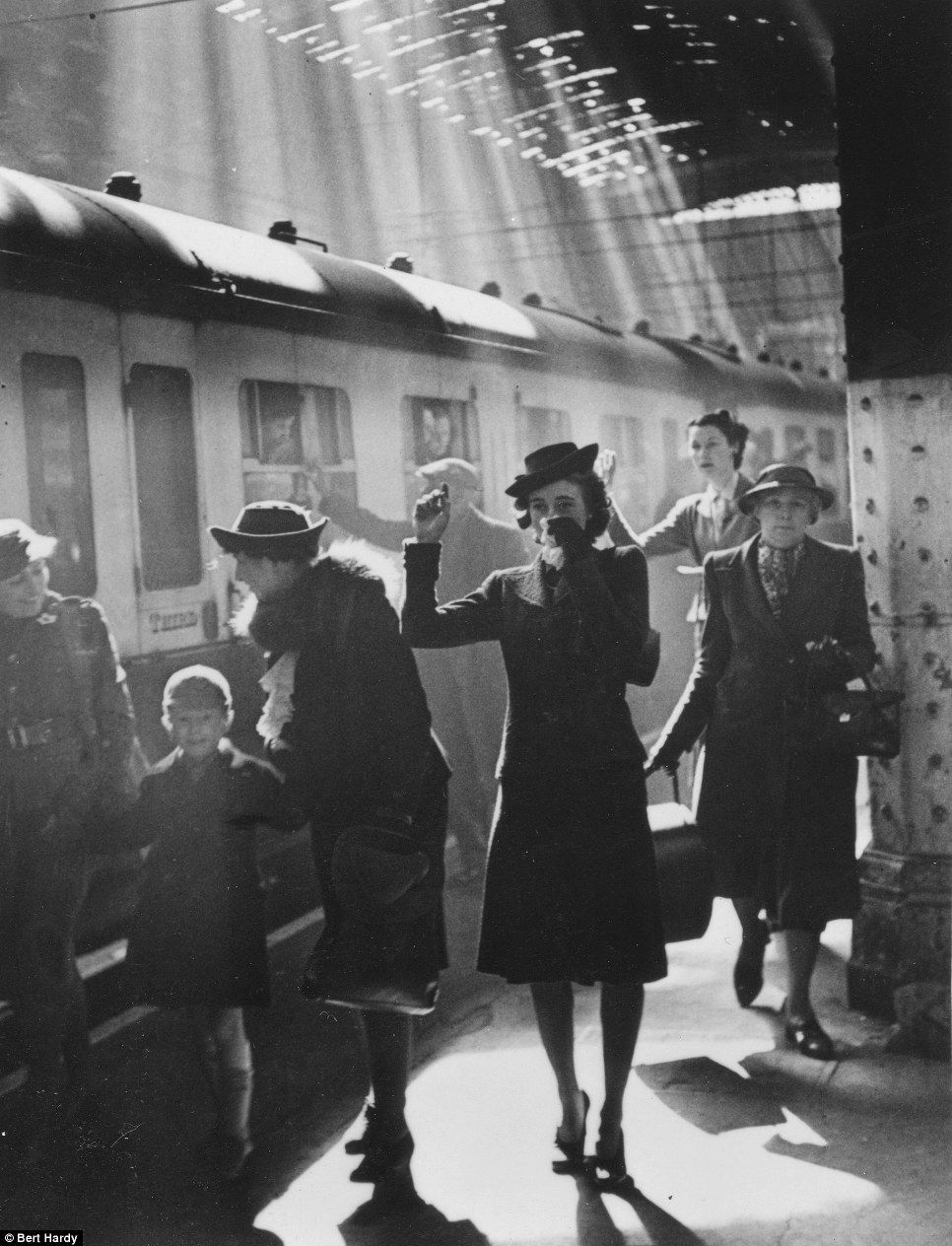 A woman bids farewell at Paddington Station in 1942 as her child is evacuated during the Blitz - lovely series of photographs taken by Bert Hardy, WW11 photographer