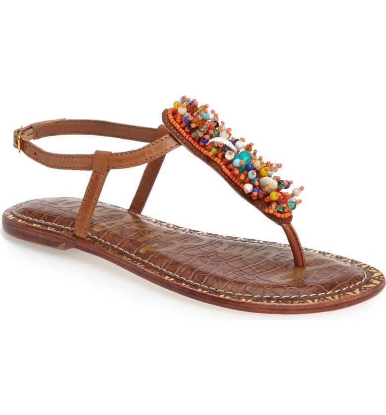 aa25affa15490 Clusters of brightly colored beads make these t-strap sandals perfectly  embellished for summer