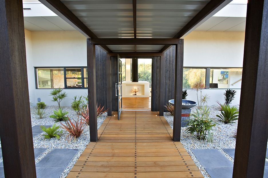 The Wooden Entrance Door Brought To Australia From The Indian Temple Looks Pretty Aloof And Yet Brings Individuality To The House