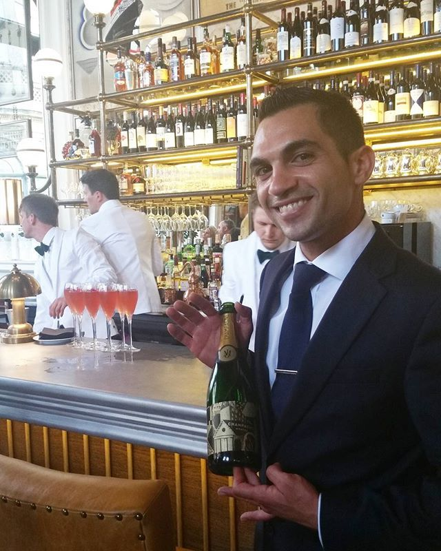 The lovely Johnny Koumourou, bar manager showing us around the new - bar manager
