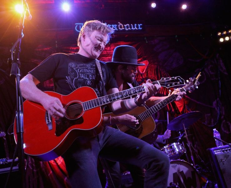 Team Coco rocks. Conan O'Brien trades jokes for riffs during a performance with Langhorne Slim & The Law on Oct. 16 in West Hollywood, Calif.