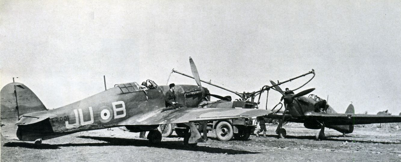 Hurricane Mk I JU-B of No 111 Squadron RAF is refuelled at RAF Wick in February 1940. Carrying fuselage roundels, the aircraft is devoid of an identification marks on its starboard wing upper surface, which may indicate it had recently been fitted with a replacement metal wing. Having previously served with No 56 Squadron RAF, the fighter had been with the squadron until it was destroyed on 19 June following engine failure whilst taking off.