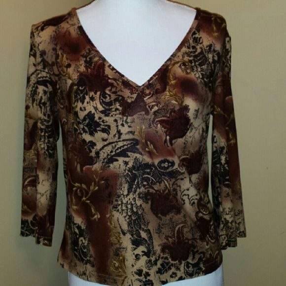 Blouse Polyester and spandex blend with low cut front. Tops Blouses