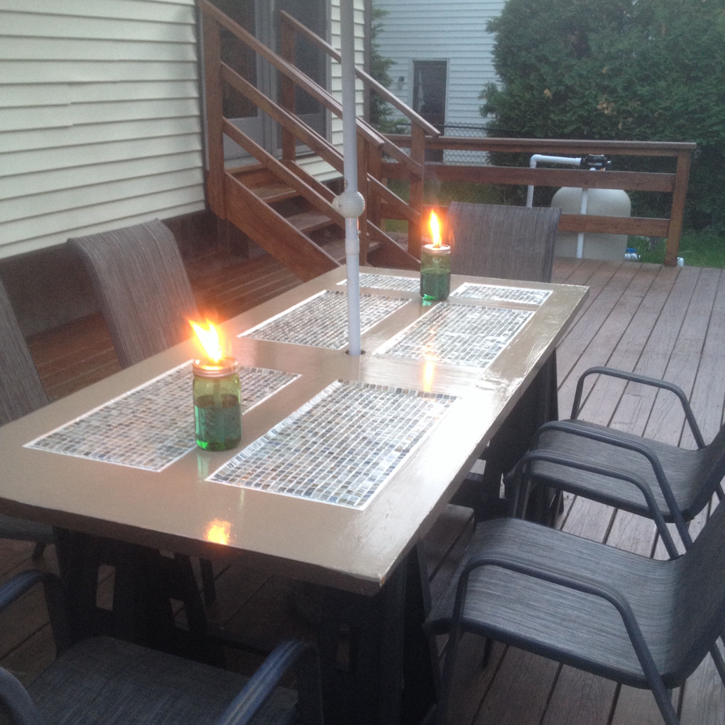 patio table made from a wooden door that we got from the habitat