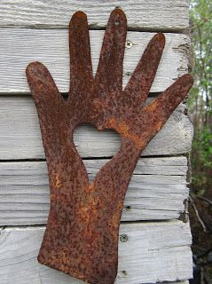 Hand of love, love in hand...fun metal wall sculpture Back to Larkrise: Loving Libraries and other things