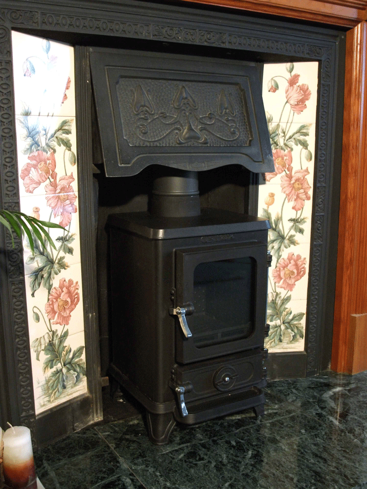 Small Woodburning Stove 14 efit hood hobbit stove - Wood Burning Stove In Victorian Fireplace €� Pinteres…