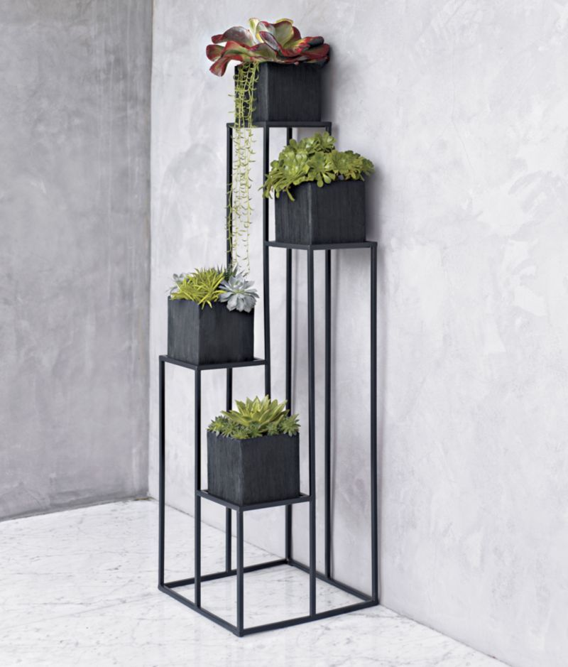Quadrant Plant Stand With Four Planters In Garden Patio